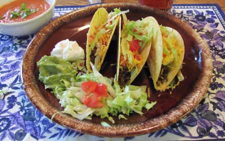 3 tacos with cheddar cheese, guacamole, lettuce and tomato. Photo/B.Yarnell