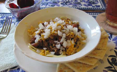 Russell's Best Chili recipe w/spaghetti, cheddar cheese and onions. Photo/B.Yarnell